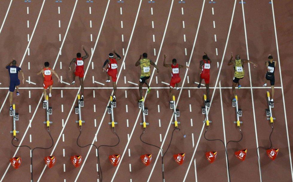 USain Bolt campeon 100 metros Beijing locos por correr 10