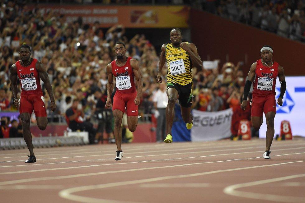 USain Bolt campeon 100 metros Beijing locos por correr 12