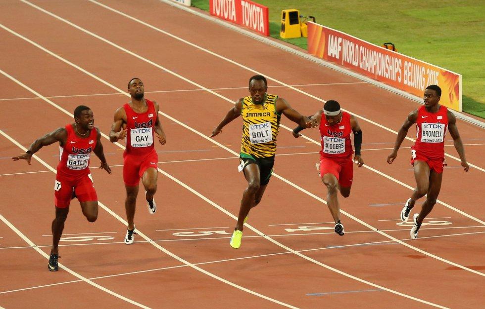 USain Bolt campeon 100 metros Beijing locos por correr 15