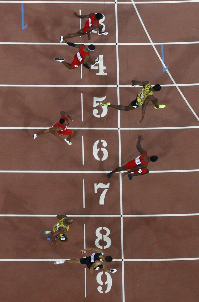 USain Bolt campeon 100 metros Beijing locos por correr 16