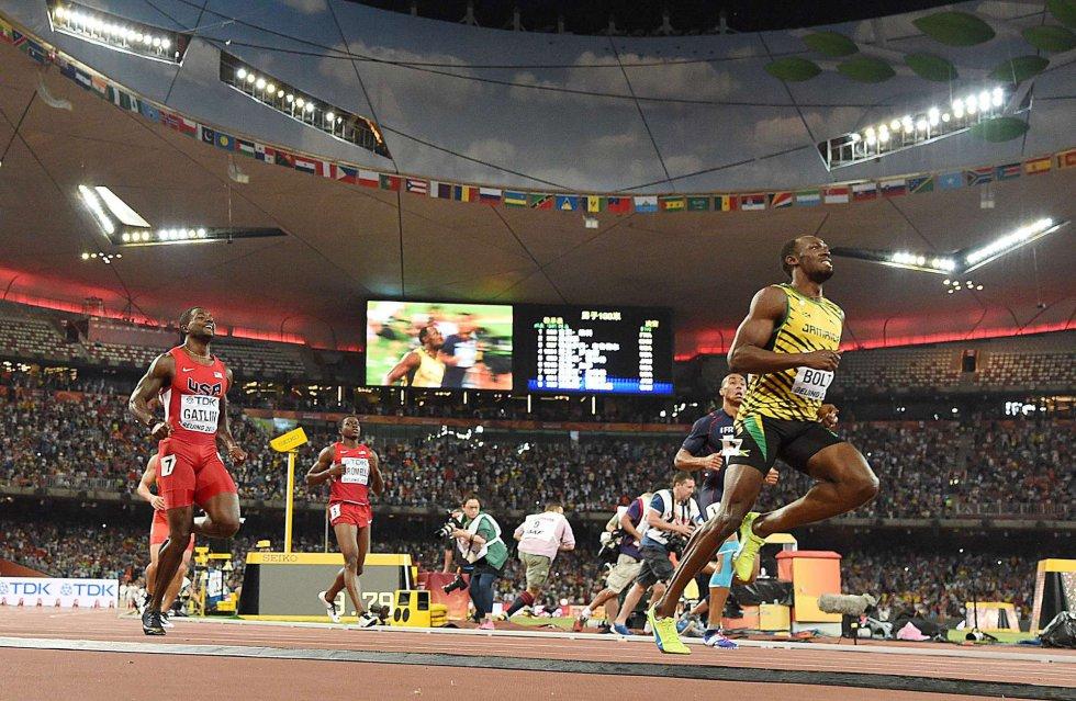 USain Bolt campeon 100 metros Beijing locos por correr 19