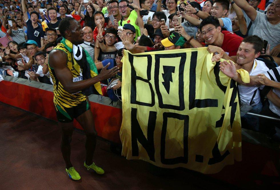 USain Bolt campeon 100 metros Beijing locos por correr 22
