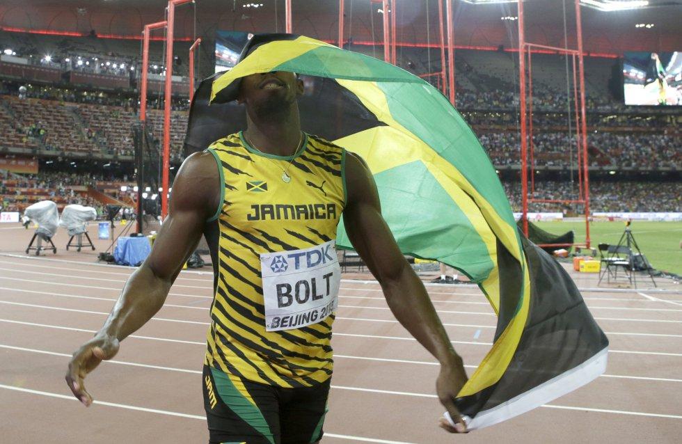 USain Bolt campeon 100 metros Beijing locos por correr 23